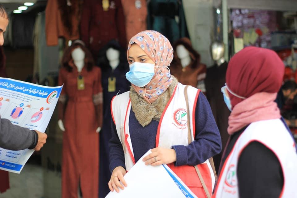 Volunteers raising awareness against covid in Gaza